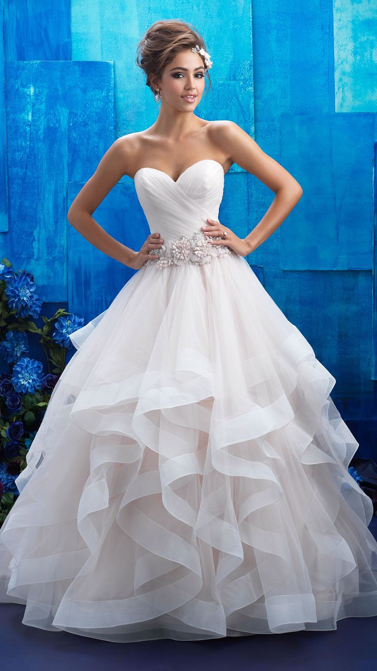 Allure Bridals style 9408. Sheer ruffles adorn this romantic strapless ball gown. The look is finished with an incredibly pretty floral belt. @allurebridals #allurebridals #ad #bridal #wedding #weddingdress #ballgown