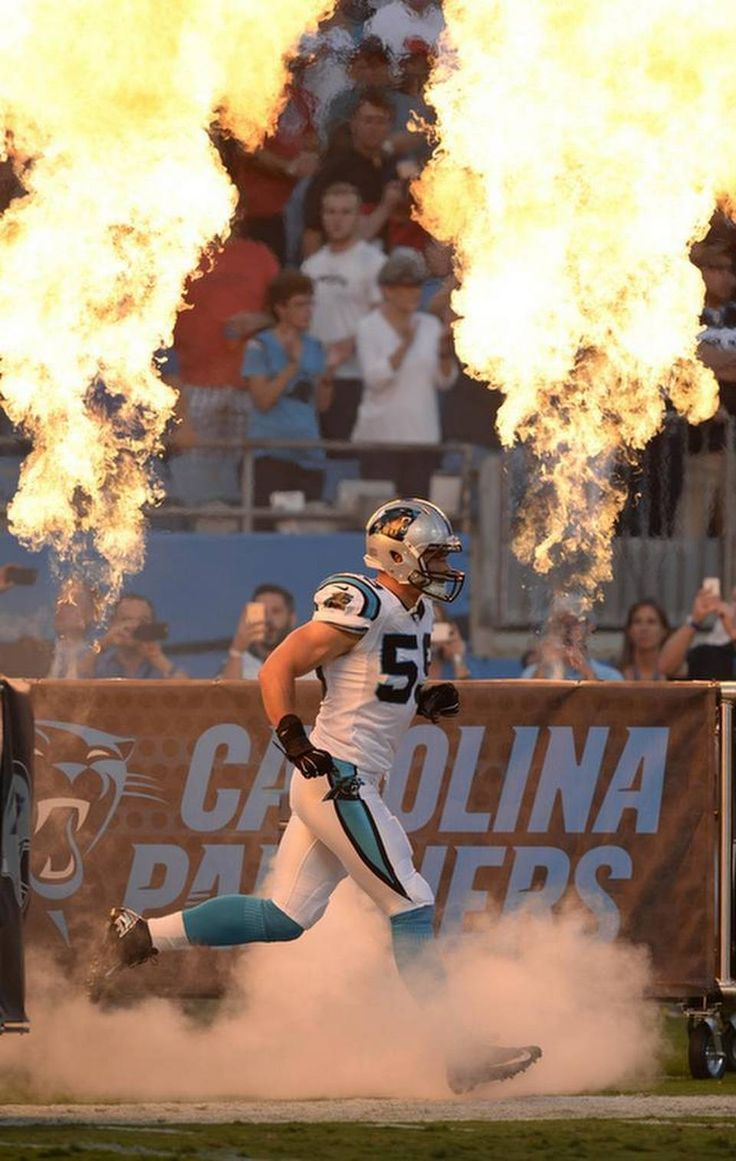 Carolina Panthers' Luke Kuechly (59) is introduced prior to playing the New England Patriots in their preseason game at Bank of America Stadium on Friday, August 28, 2015. New England won, 17-16.