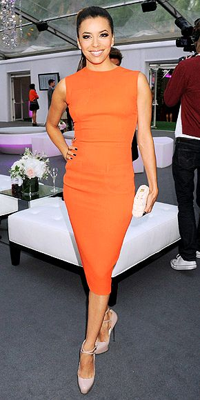 In London for the Glamour event, Eva opts for a curve-hugging orange Victoria Beckham sheath, nude ankle-strap Brian Atwood platforms and a simple white clutch.  Perfection.