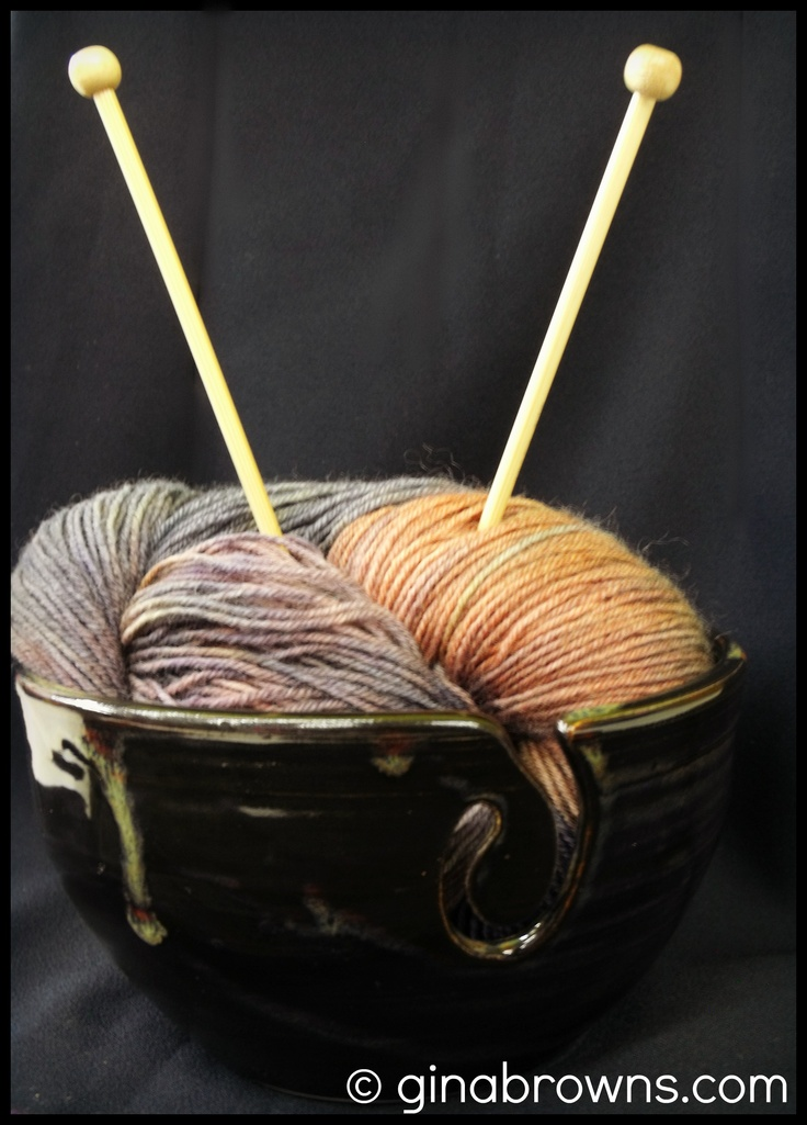 *Sorry knitters! This bowl has sold.* This yarn bowl is mostly black with interesting undertones of bronze and navy!