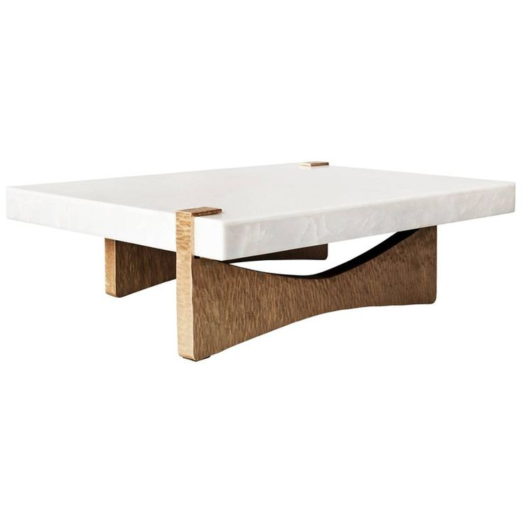 For Sale on 1stdibs - The Moore coffee or cocktail table by DeMuro Das has a stone top in White Onyx, supported by a hand-cast sculptural base in a beaten Bronze finish. This