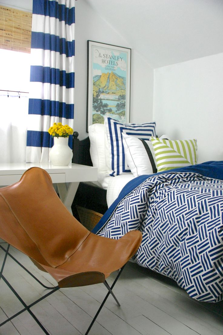 1091 best boys bedroom images on pinterest boy bedrooms bunk crisp fresh blue and white room with leather butterfly chair and painted white floors two different navy white patterns and change the green accent to