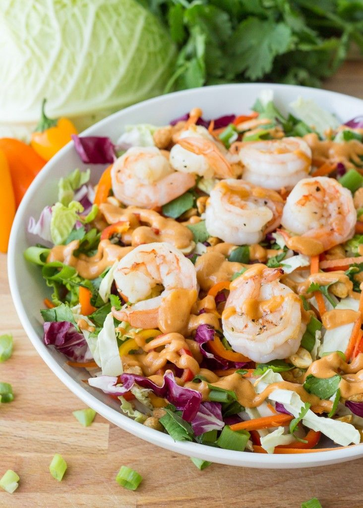 This wonderful crunchy Thai #Shrimp Salad is absolutely packed with flavor. Lettuce, savoy cabbage, carrots, and radicchio is tossed with green onions, cilantro, and peanuts. It's then topped with grilled shrimp and drizzled with a creamy and spicy peanut dressing.