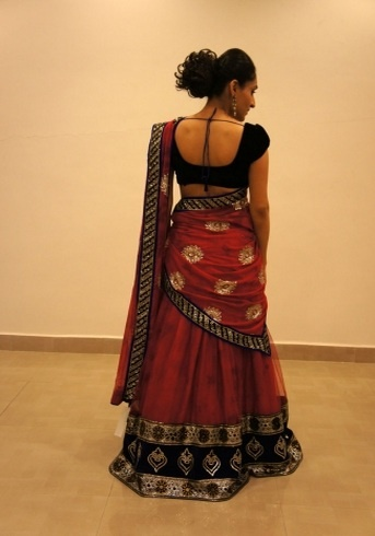 Red -Blue Lehenga!    Red Blue ghaghra/half saree. The skirt and the dupatta are dyed in shades of red and maroon in a random fashion to give it a texture kind of appearance. The embroidery is kept light, in consistent with the fabric, and the entire ensemble is highlighted with blue trimmings.    For more details,  www.czari.in/women