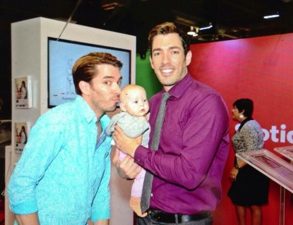 It's MrSilverScott @Drew Scott Kissing #Babies at @HomeShowsAB #Calgary #PropertyBrothers