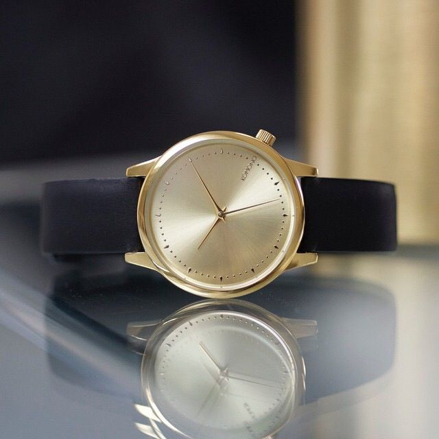Komono - Estelle Black with Gold case and sunray dial
