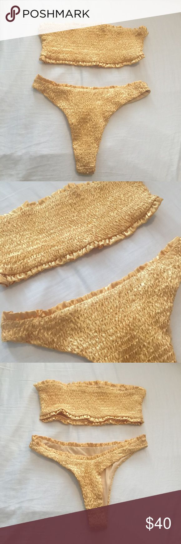 "Yellow - Gold Bandeau Bikini Set NWOT Size Small for top and bottom / Yellow- Gold Bandeau Bikini Set / Top is bandeau style,  bottoms are very cheeky Brazilian cut / NEW without tags! – never been worn/ ▫️PRICE IS FIRM!   Laying Flat: Across bandeau top 12"" Full length bandeau top 6"" Across Waist (bottoms) 13""   ✨will not model Swim Bikinis"