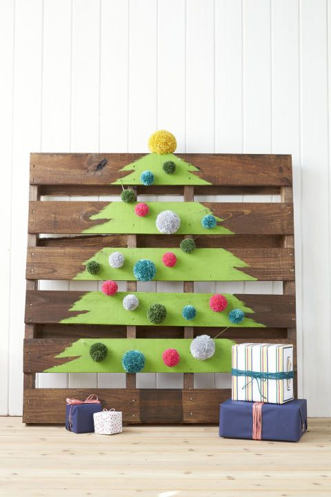 Paint a tree on a shipping crate (you can find 'em for cheap on eBay), and embellish the slats with pom-poms.