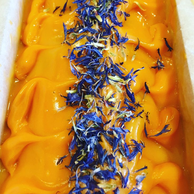 Sweet orange and blue cornflower handmade natural soup in the mould.