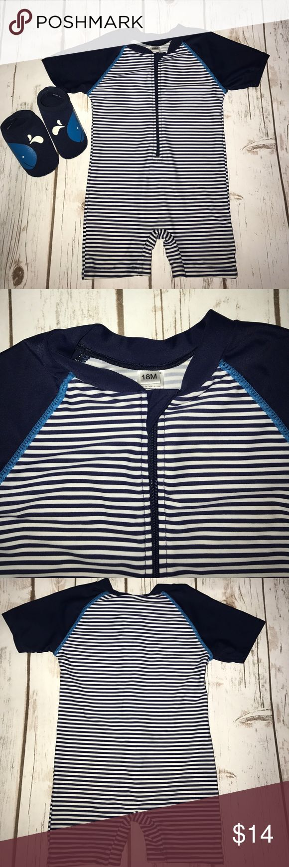 """Kids One Piece Swearwear Rash Guard EUC. Zipper closure at top. Navy blue and white stripes. Says """"18 months"""" on tag but fit my son well at 12 months IMO. When I ordered this online I selected """"12-18 months"""" and this is what was sent to me. Water shoes not included but do have a separate listing 😃 smoke free home. Swim Rashguards"""