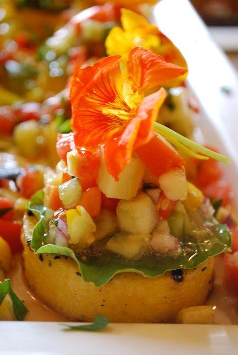 Polenta stack with heirloom tomato salad and a fresh nasturtium #weddings #catskills #hudsonvalley #menu #catering #vegan #vegetarian #slowfood #foodie