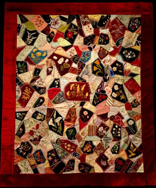 "Victorian Crazy Quilt with embroidery stitches. [Crazy Quilt with Initial ""M,"" c. 1885; made by Minnie K. Minderlein in Baltimore, MD]"