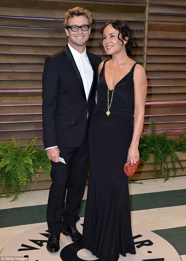 So in love: Simon and his wife Rebecca Rigg are seen attending the 2014 Vanity Fair Oscar ...