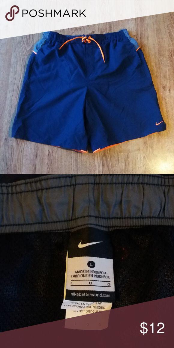 Mens Nike Swim Trunks Mens Nike Swim Trunks  with liner.  Blue/Gray/Orange.  Length 8 inches /  Waist 32 inches Nike Swim Swim Trunks