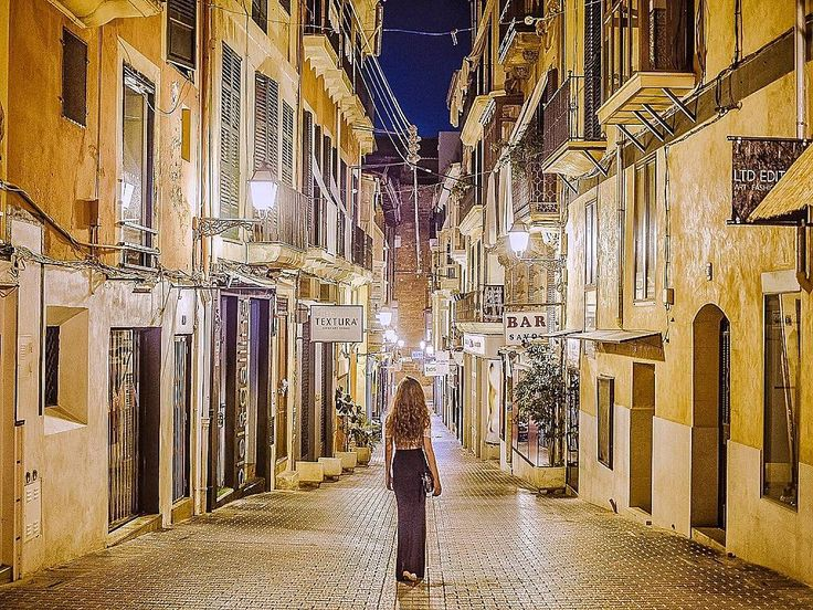 Wandering the streets of Mallorca at night   Some of these little streets were completely empty and quiet but in the vicinity there were cafés and pubs full of people. Loved the vibe of the old city!  You can read more about exploring this Spanish island on the blog  link in bio  . . . . #travelblogger #ivegotsunshine #ontheblog #linkinbio #linkinprofile #dametraveler #wearetravelgirls #darlingescapes #traveletting #visualsoflife #wonderful_places #exploreeverything #instapassport…