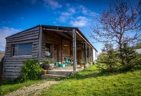 The Hop Shack is an upcycled static caravan clad in local timber & recycled corrugated tin.