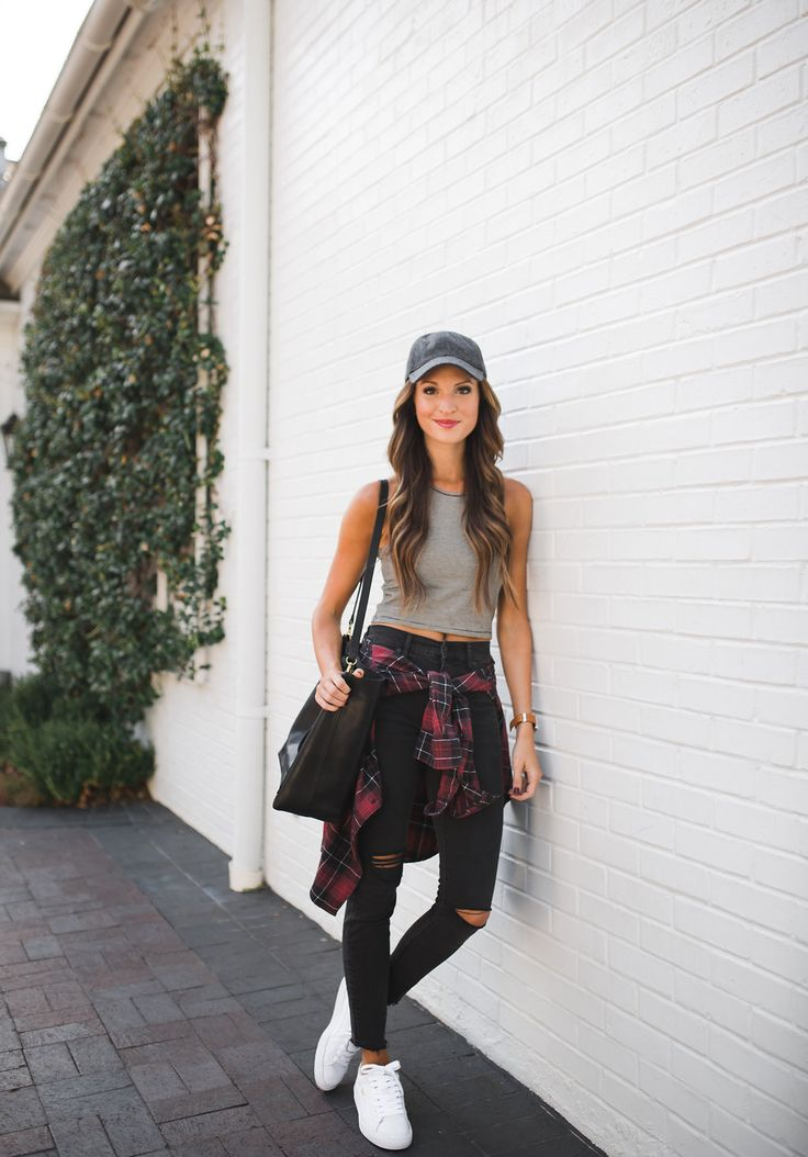 Striped tank top + high waisted distressed skinny jeans + flannel shirt + white sneakers + baseball cap