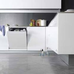 concrete flooring with white cupboards