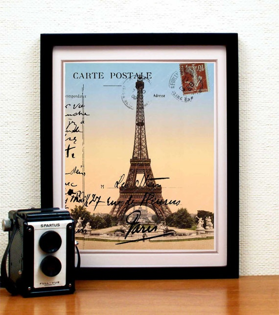 An archival print of an original collage by piddix, made with layers and layers of ephemera including an image of the Eiffel Tower from the 1889s (the year the Eiffel Tower was built). This same image is featured on journals at Target.