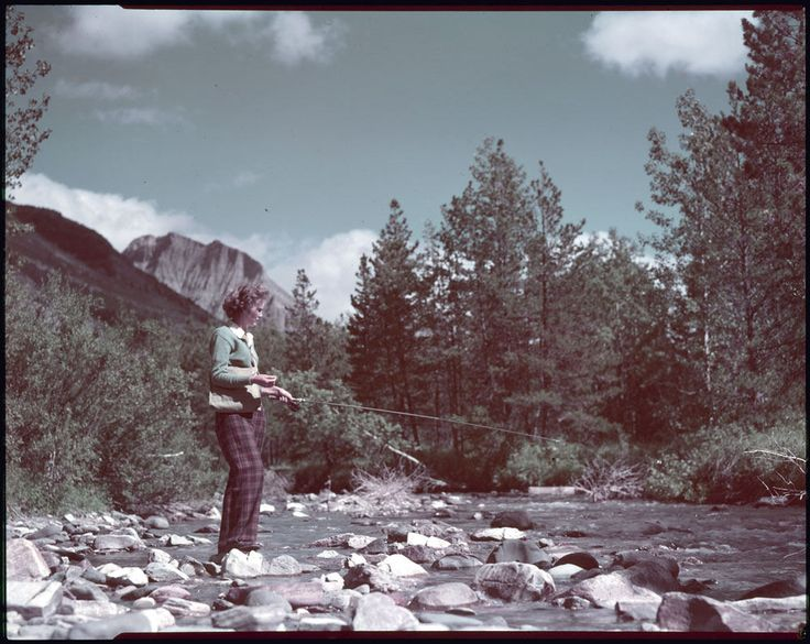 Frances Barraclough of Calgary, Alberta, fishing in Cameron Creek, Waterton Lakes National Park, Alberta / Frances Barraclough, de Calgary (Alberta), pêche à Cameron Creek, au parc national des Lacs-Waterton, en Alberta | by BiblioArchives / LibraryArchives