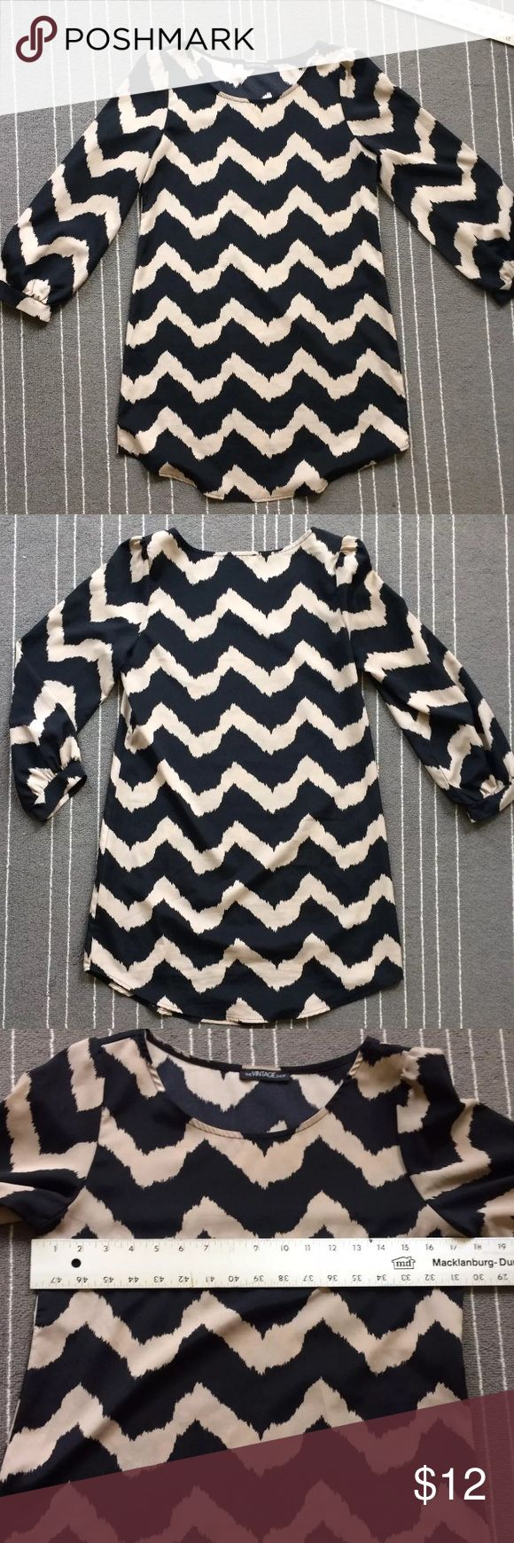 "The Vintage Shop black and taupe chevron top Excellent condition chevron pattern dress or top size small from The Vintage Shop.  Unlined polyester has long sleeves puff hem sleeves.  Measures flat approximately 18"" across chest and 32"" lengthwise. The Vintage Shop Tops Tunics"