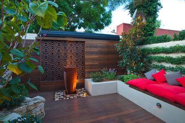 "15. Create a focal point. As with adding character, a focal point takes attention off the size of the space. Arthur likes to use water features. He's even added a single large planter right in the center of a small backyard to draw the eye into the center and push the walls away. ""It's a trick of the eye,"" he says."