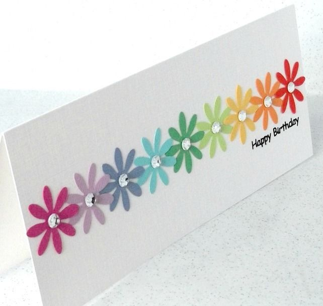 Handmade birthday card with rainbow flowers punched from high quality cardstock.