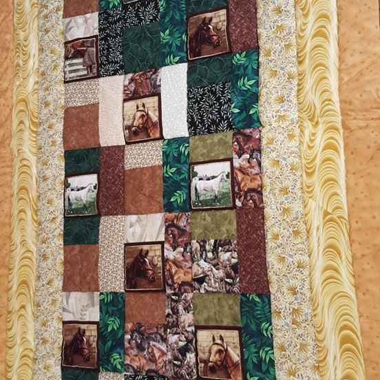 A must for Horse lovers of all ages.  A single bed size topper / throw rug whats a topper? A topper is a quilt size that goes over the top of the bed, it doesnt hang over the sides. Created in the colours associated with Horses. Creams, Browns and Green Measurements are 120 cm x 215 cm quilt quality cotton with cotton wadding.  Machine washable. Not your colour scheme ... NO PROBLEM, contact us and discuss your preferred colour selection and we can create ONE OF A KIND quilt just for you...