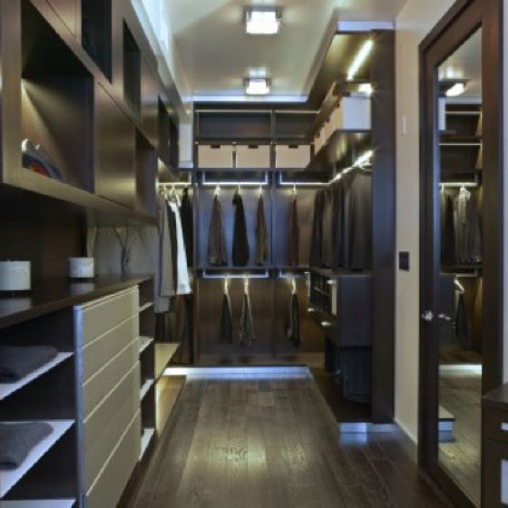This is the best shape for a closet, a big rectangle with the entrance on one end. As long as it's wide enough you can have plenty of room for everything you need.