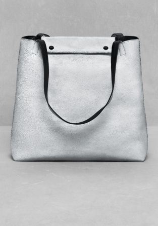 An edgy-chic leather tote with an exclusively cracked surface.