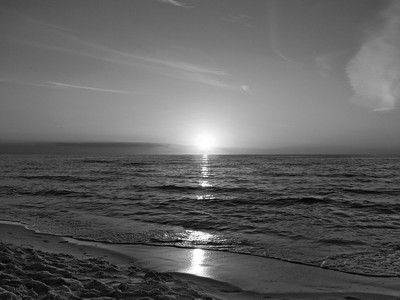 Sun is sinking into the sea B&W