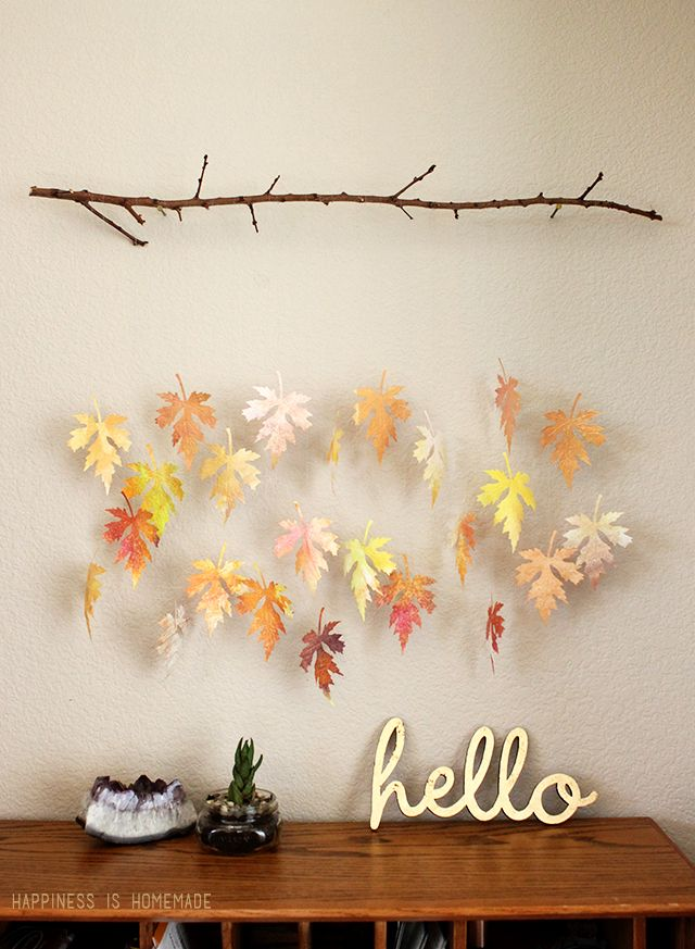 This watercolor leaf and branch mobile is gorgeous! Make your own leaves with watercolor paintings