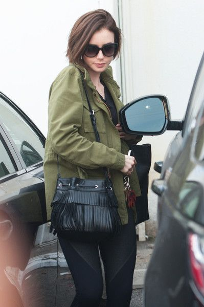 Lily Collins steps out to meet friends.