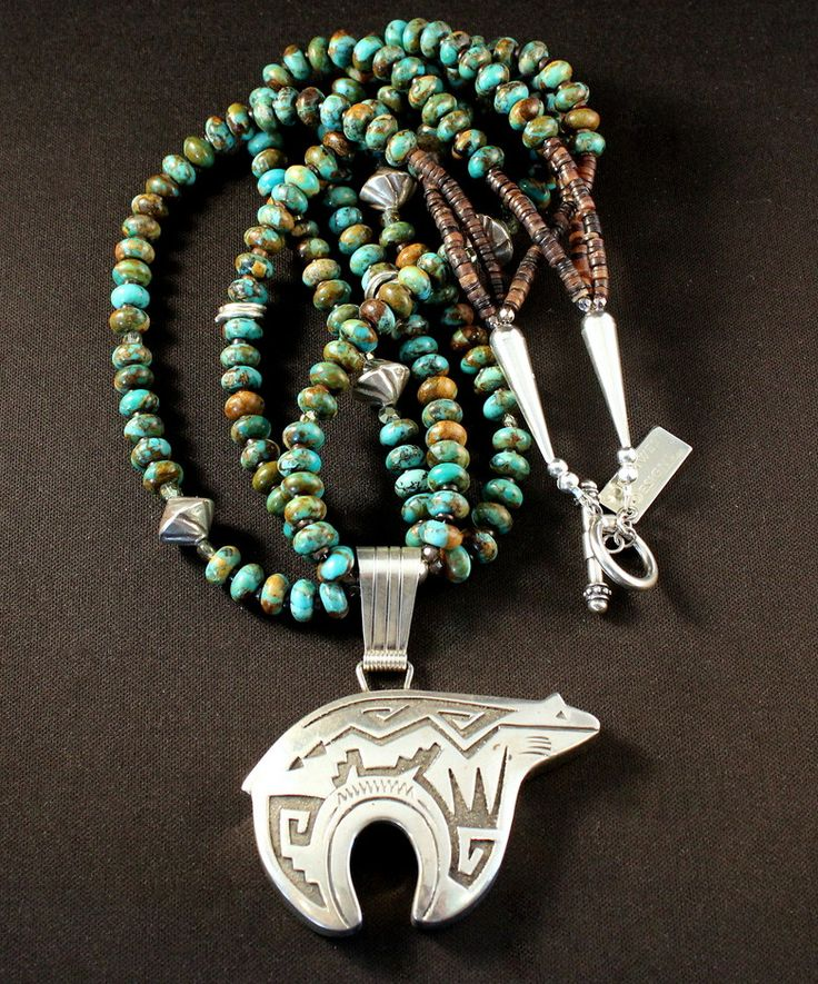 This elegant Necklace features a Sterling Silver Bear Pendant by Navajo artist Richard Singer. The Pendant is beautifully crafted, displaying traditional Navajo designs that have been oxidized for gre