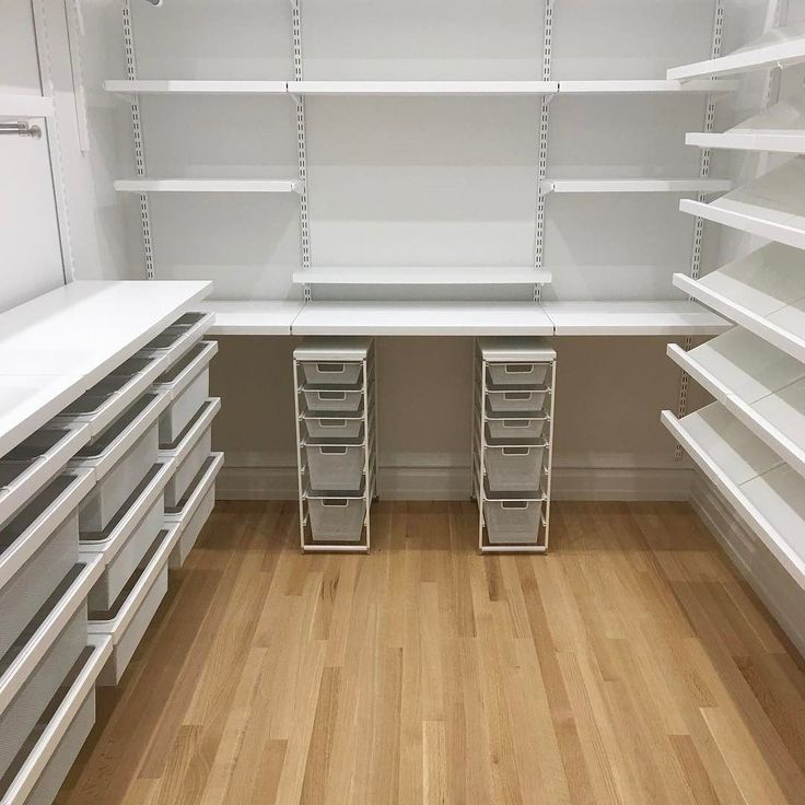 Oh @thecontainerstore how we love you! Check out this walk in closet (with a vanity along the back wall!) that we recently install for a client.  #thecontainerstore #elfa #shelving #closets #custom #builtin #organizingmadeeasy