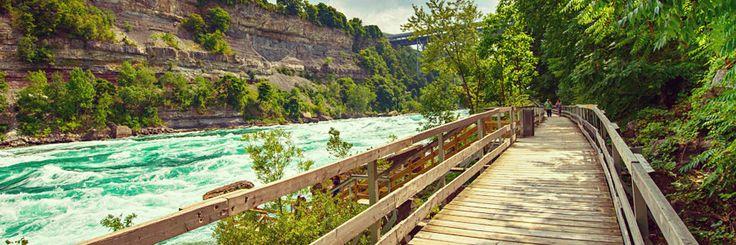 Wooden boardwalk next to whitewater rapids