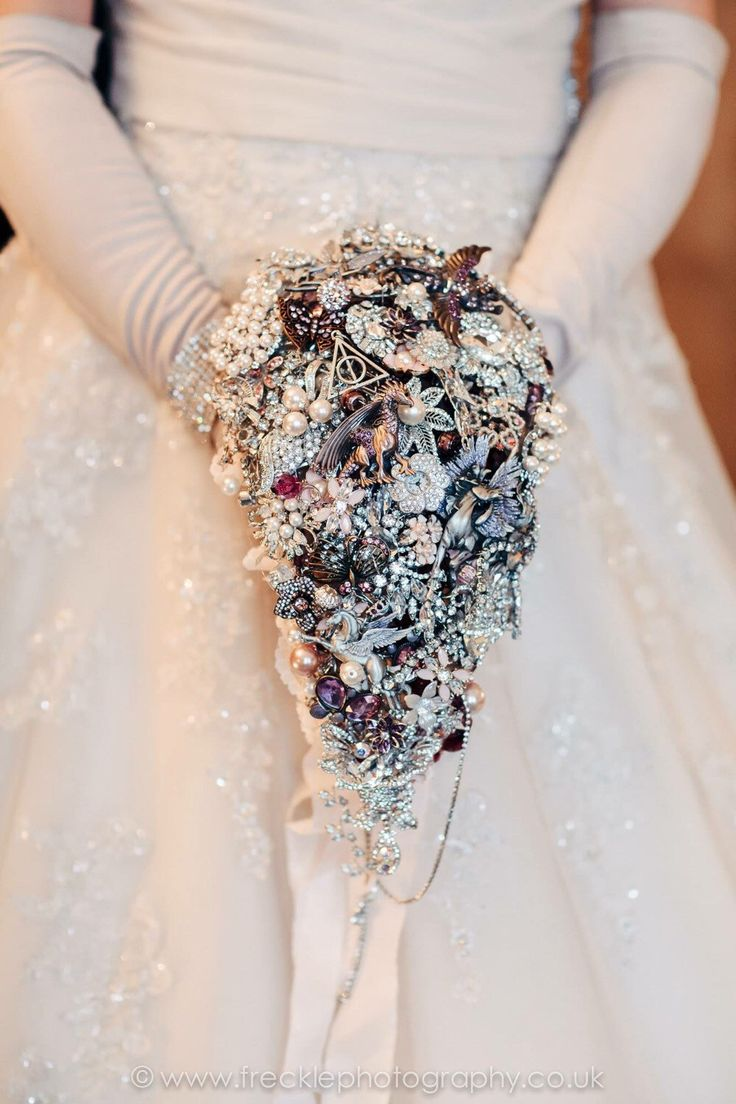 Large cascading fantasy wedding brooch bouquet, brides jewel bouquet, broach bouquet, harry potter wedding, lord of the rings wedding fairy  https://www.etsy.com/uk/listing/267517829/large-cascading-fantasy-wedding-brooch