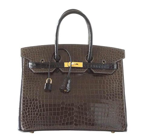 Don't miss out on this amazing Hermès Birkin bag featured in the size 35. Made from exotic porosus crocodile skin, this bag is valuable and super rare.