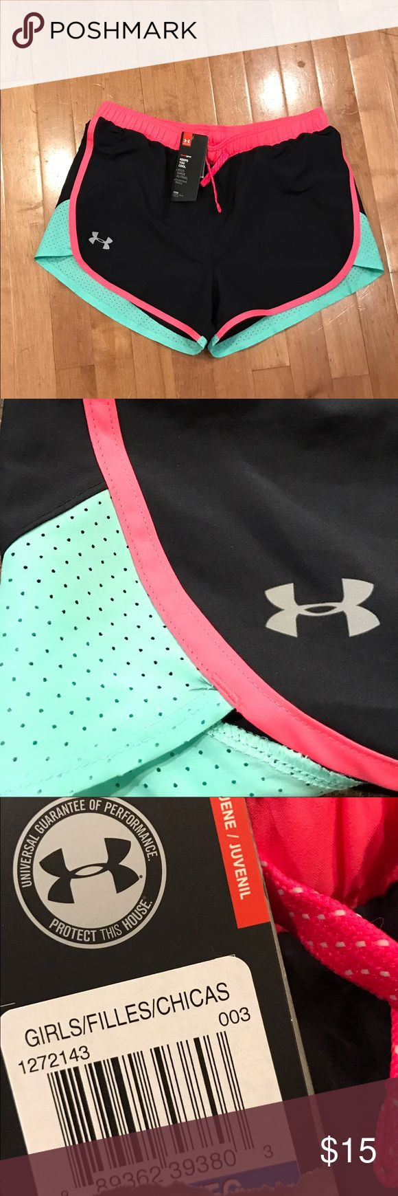 Girls Under Armour shorts Cute and colorful Under Armour shorts are NWT in a black with mint green and pink accents. Youth XL. Under Armour Bottoms Shorts