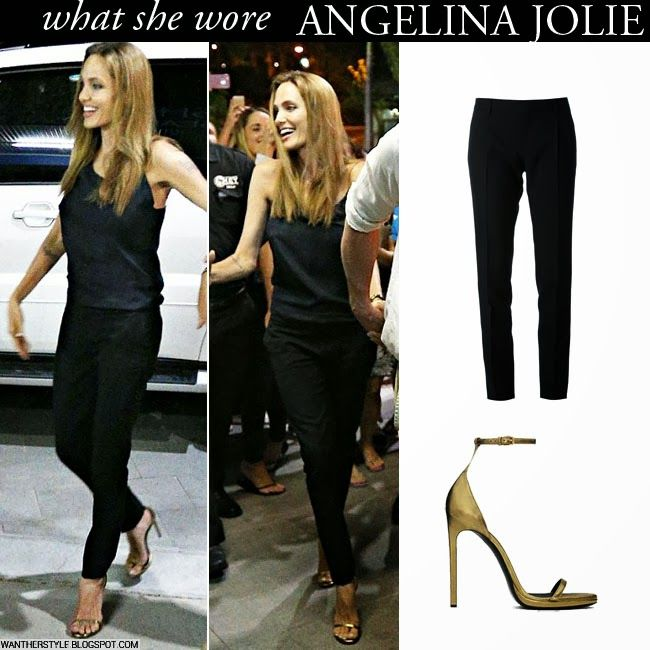 Angelina Jolie in black Saint Laurent pants, black top and gold open toe strap sandals