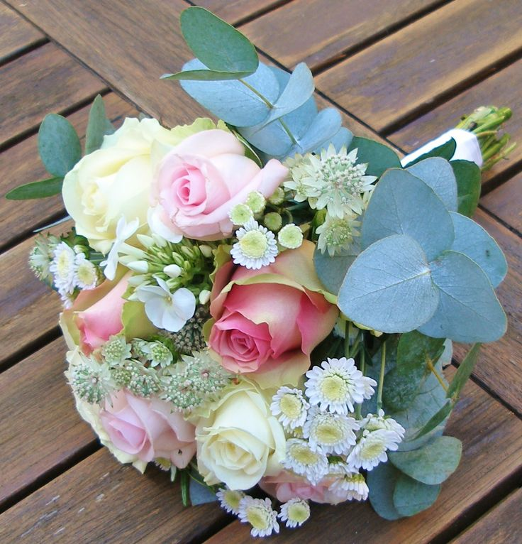 Gorgeous hand tied Bridesmaid Bouquet of pink roses, ivory cream roses, astrantia, phlox and eucalyptus by Rockingham Flowers, Kettering.