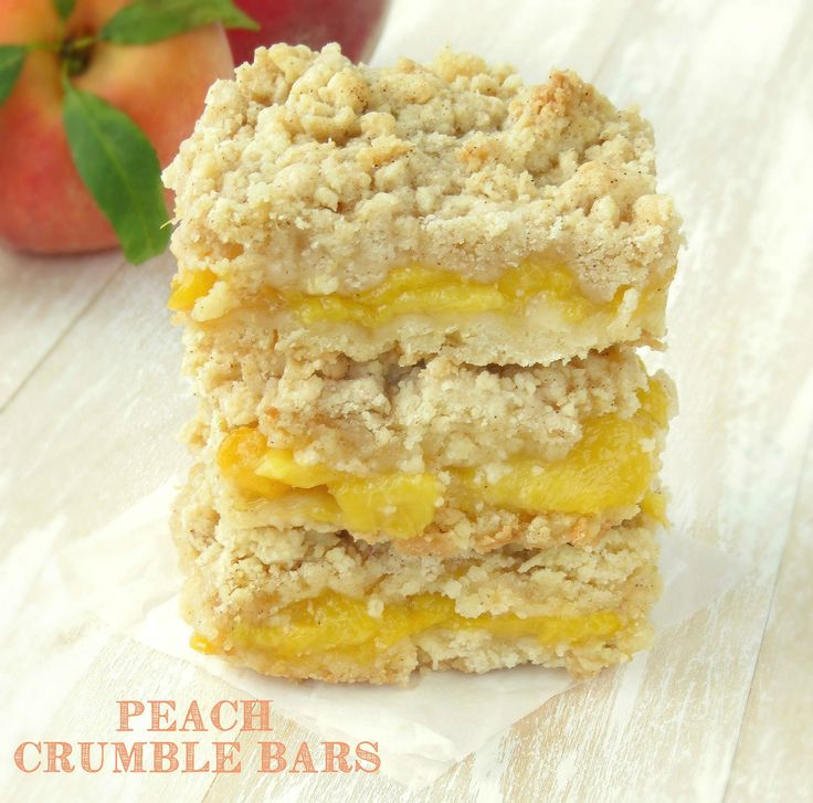 Peach Crumble Bars. Gooey homemade peach filling is sandwiched between a buttery crust and a sweet delicious crumb topping!