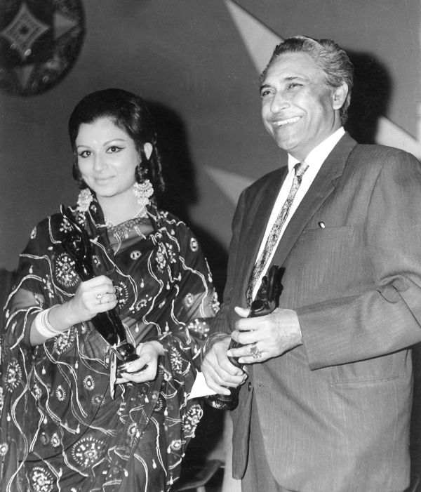Sharmila Tagore and Ashok Kumar with their winning trophies.