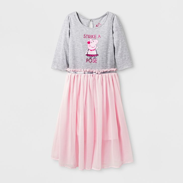 Peppa Pig knows what's going on. Let your little girl strike a pose in the Peppa Pig® Skater Dress while she sports her favorite porcine friend. The light, flowy tulle skirt makes for a dainty and ethereal look. She'll be comfy in a soft cotton blend, while the sparkly lettering and back-button closure add simple, girly detail. Pair with ballet flats for a complete look that is soft and dainty, or grab a pair of tights and bright combat boots for an eccentric ense...