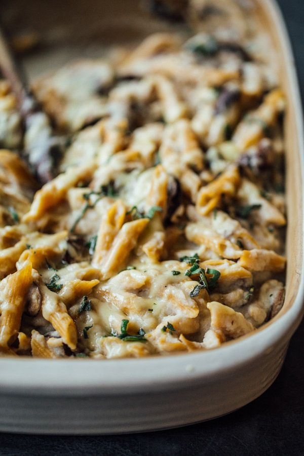 Healthy Mushroom Alfredo Pasta Bake with pan-roasted mushrooms, whole wheat penne pasta, creamy cauliflower sauce, and Gruyere cheese.