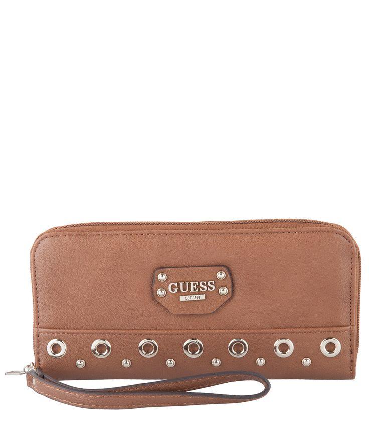 Deze Jodi Large ZipAround wallet van Guess is gemaakt van een PU leersoort met verschillende gouden details en het Guess logo op de voorzijde.
