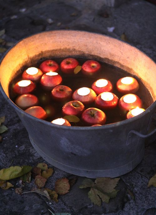 Tea lights in apples in a tub of water. Perfect fall wedding decorations.