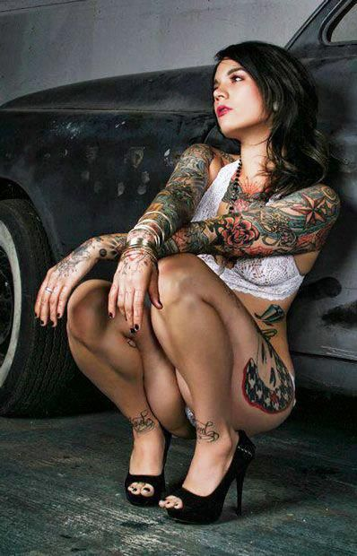 Tattooed car sales girl in asian showroom 9