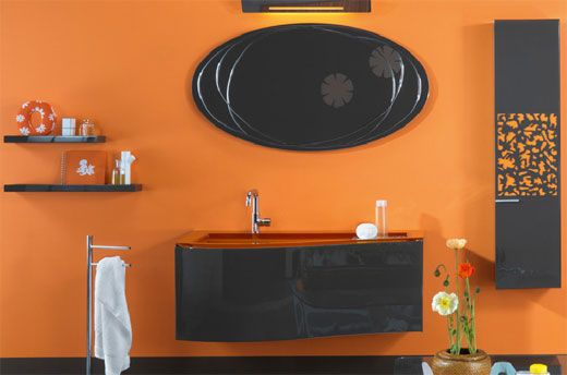 Dare to Have an Orange Bathroom: try to combine orange with black if you are a bit dark and more daring. It is interesting and shows sophistication and style. From homedit.com