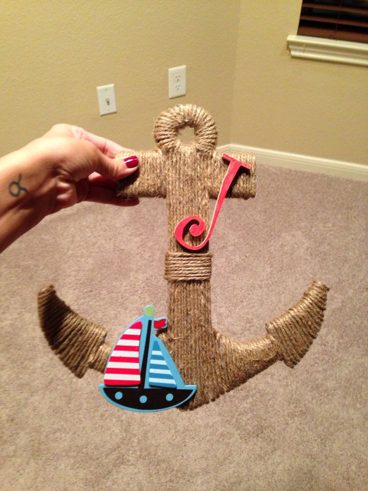 Made an actor for my friends baby shower. I'm so happy with the way that it turned out.  Hobby Lobby is my best friend.  All you need is a plywood cut out and some twine ( and some patience)! I also added a sail boat and a letter J that I painted for her new baby boy's name.